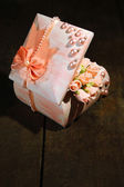Beautiful hand made casket with roses, on wooden background — ストック写真