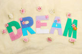 Word Dream created with brightly colored knitting yard on fabric background — Foto Stock