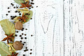 Herbs and spices border, on wooden background — Stock Photo