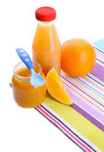 Jars of various baby food with orange, isolated on white — Stock Photo