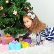 Little girl decorating Christmas tree — Stock Photo #39029323