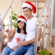Young couple celebrating New Years in new home on stairs background — Stock Photo #39029567