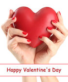 Red heart in woman hands, isolated on white — Stock Photo