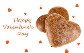 Galletas de chocolate en forma de corazón aislado en blanco — Foto de Stock