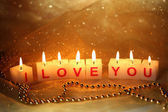 Candles with printed sign I LOVE YOU,on blur lights background — Foto de Stock