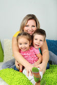 Little children with mom in room — Stock Photo