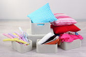 Plastic baskets with things in floor on room background — Stock Photo