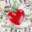 Stock Photo: Love and money concept. Heart on Europeand Americmoney