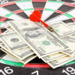 Dart on dartboard and money close up. Concept of success. — Stock Photo #39030213
