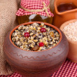 Pot with kutia - traditional Christmas sweet meal in Ukraine, Belarus and Poland, on wooden background — Stock Photo