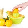 Preparing fresh lemon juice squeezed with hand juicer isolated on white — Stock Photo #39031765