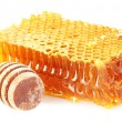 Sweet honeycomb and wooden drizzler, isolated on white — Stock Photo #39039307