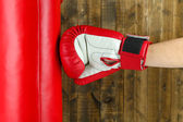 Box training and punching bag, on wooden background — Stock Photo