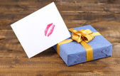 Gift with card for loved one on table close-up — Stock Photo