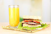 Fresh and tasty sandwich on plate on table on light background — Stock Photo