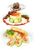 Small portions of food on big white plates isolated on white — Stock Photo