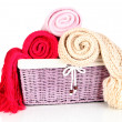 Warm knitted scarves in basket isolated on white — Stock Photo #39040649