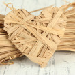 Decorative straw for hand made and heart of straw, on wooden background — Stock Photo #39040799
