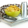 Stock Photo: Chips in bowl and TV remote isolated on white