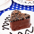 Sweet cakes with chocolate on plate on table close-up — Stock Photo #39041413