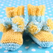 Crocheted booties for baby, on color background — Stock Photo #39041857