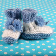 Crocheted booties for baby, on color background — Stock Photo #39041861