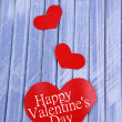 Foto Stock: Paper hearts on wooden background