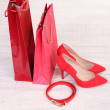 Beautiful red female shoes, belt and shop bags — Stock Photo #39043655