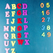 English alphabet and numbers on school desk background — Stock Photo #39045075