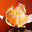 Ripe sweet tangerine, on dark color background — Stock Photo