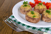 Stuffed mushrooms on plate on table close-up — Stock Photo