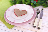 Set of utensil for romantic dinner, on table, on light background — Stock Photo