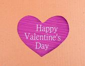 Cardboard heart on purple background — Stock Photo
