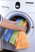 Washing machine loaded with clothes close-up — Stock Photo