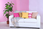 White sofa in room on pink wall background — Stock Photo