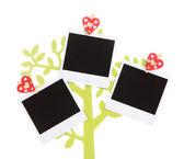 Halter in Form eines Baumes mit sofortigen Foto-Karten, die isoliert auf weiss — Stockfoto