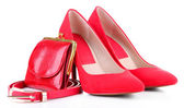 Beautiful red female shoes, purse and belt, isolated on white — Stock Photo