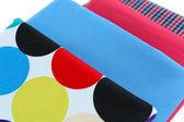 Pile of colored fabrics close up — Stock Photo