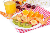 Sweet fresh fruits on plate on table close-up — Stock fotografie