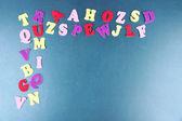 English alphabet on school desk background — Stock Photo