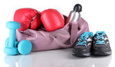 Sports bag with sports equipment isolated on white — Stockfoto
