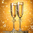Two glasses of champagne on bright background with lights — Stock Photo #39160237