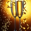 Two glasses of champagne on bright background with lights — Stock Photo #39160303
