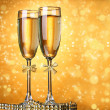 Two glasses of champagne on bright background with lights — Stock Photo #39160325