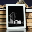 Stock Photo: Tablet with house sketch project and books