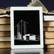 Tablet with house sketch project and books — Stock Photo