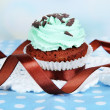 Stock Photo: Tasty cupcake on table on light background