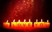 Candles with printed sign I LOVE YOU,on blur lights background — Photo