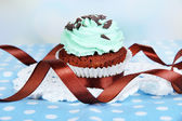 Tasty cupcake on table on light background — Stock Photo