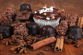 Tasty cupcake with different sweets close up — Stock Photo